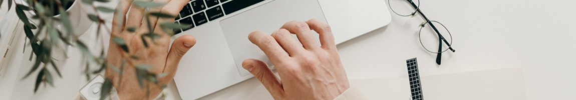 person-in-beige-long-sleeve-shirt-using-macbook-pro-4065876